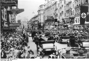 "Cheering crowds greet the Nazi ""occupiers"" in Vienna in March 1938 (Image from the German Federal Archive, via Wikimedia Commons)"