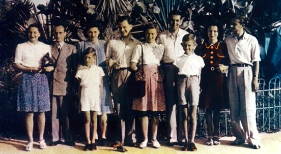 Left to right: Anna Kornmehl and her husband Isaac Feigenbaum; Rita Jeret, with her hand on the shoulder of the narrator, Manfred Wolf, and her husband Itscho Kornmehl; Bertha Kornmehl [narrator's mother] and her husband Moses (Max) Wolf behind Manfred's older brother Siegfried; Melitta Heuschover and her husband Paul Kornmehl.