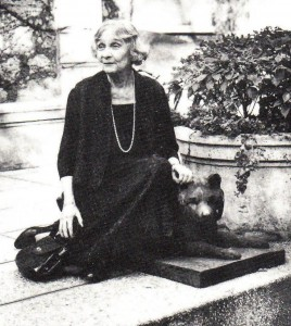 Princess Marie Bonaparte sitting on Oscar Nemon's Sculpture of Topsy, Paris, 1961