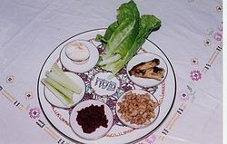 Seder plate, via Wikimedia commons. The charoses is at 3 o'clock.